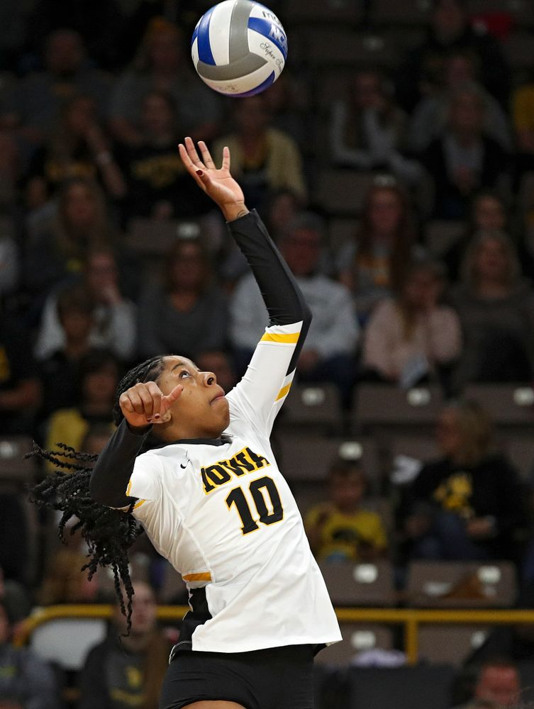Iowa's Griere Hughes (10) tips the ball over during the second set of their volleyball match at Carver-Hawkeye Arena in Iowa City on Sunday, Oct 13, 2019. (Stephen Mally/hawkeyesports.com)
