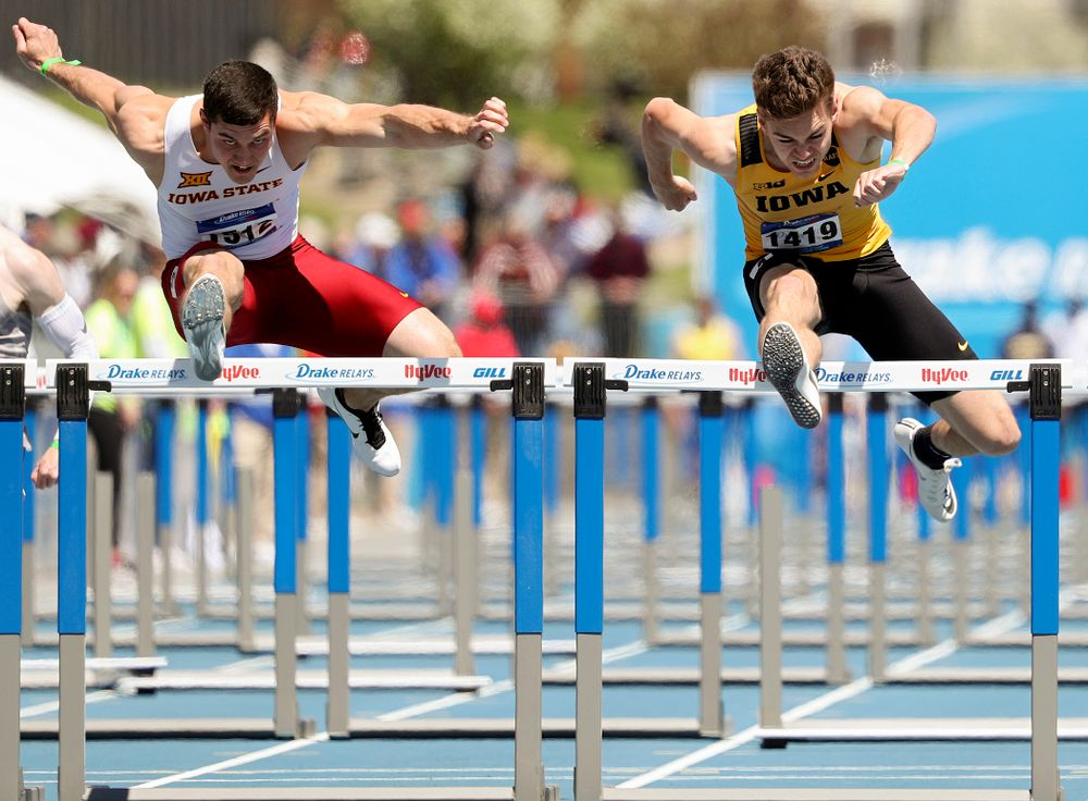 Iowa's Chris Douglas runs the men's 110 meter hurdles event during the second day of the Drake Relays at Drake Stadium in Des Moines on Friday, Apr. 26, 2019. (Stephen Mally/hawkeyesports.com)