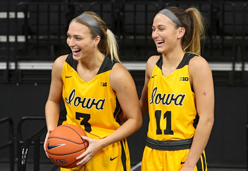Iowa guard Makenzie Meyer (3) and guard Megan Meyer (11) laugh as they pose for a picture during Iowa Women's Basketball Media Day at Carver-Hawkeye Arena in Iowa City on Thursday, Oct 24, 2019. (Stephen Mally/hawkeyesports.com)
