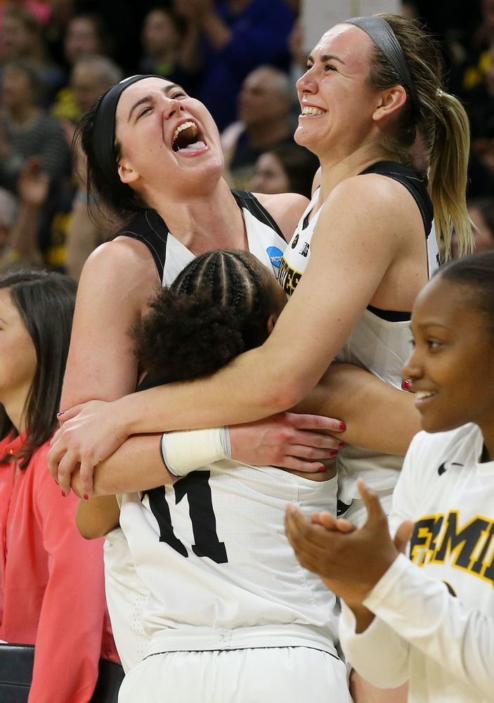 Iowa Hawkeyes guard Tania Davis (11), center Megan Gustafson (10), and forward Hannah Stewart (21) celebrate after winning their second round game in the 2019 NCAA Women's Basketball Tournament at Carver Hawkeye Arena in Iowa City on Sunday, Mar. 24, 2019. (Stephen Mally for hawkeyesports.com)