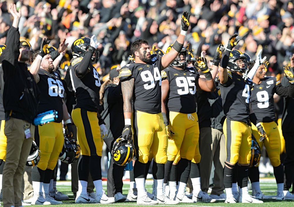 Iowa Hawkeyes defensive end A.J. Epenesa (94) and teammates wave to the University of Iowa Stead Family Children's Hospital between the first and second quarter of their game at Kinnick Stadium in Iowa City on Saturday, Nov 23, 2019. (Stephen Mally/hawkeyesports.com)