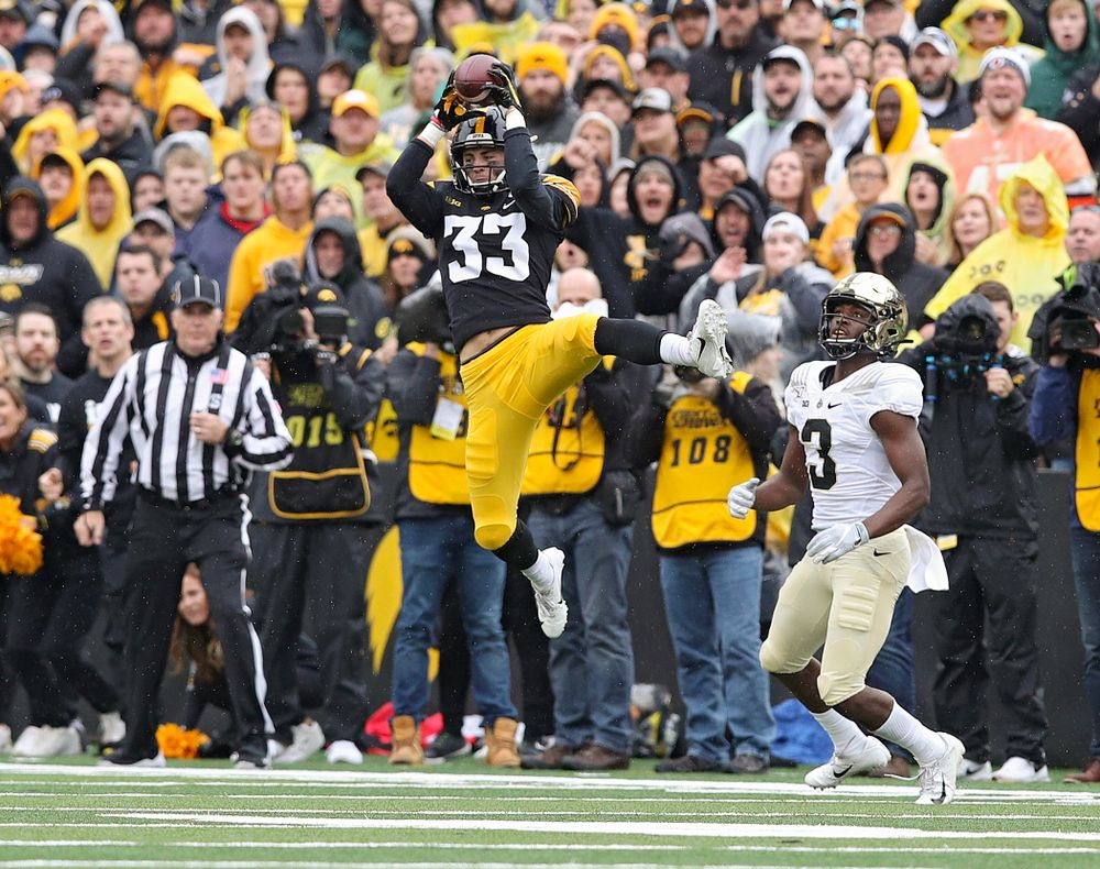 Iowa Hawkeyes defensive back Riley Moss (33) intercepts a pass during the third quarter of their game at Kinnick Stadium in Iowa City on Saturday, Oct 19, 2019. (Stephen Mally/hawkeyesports.com)