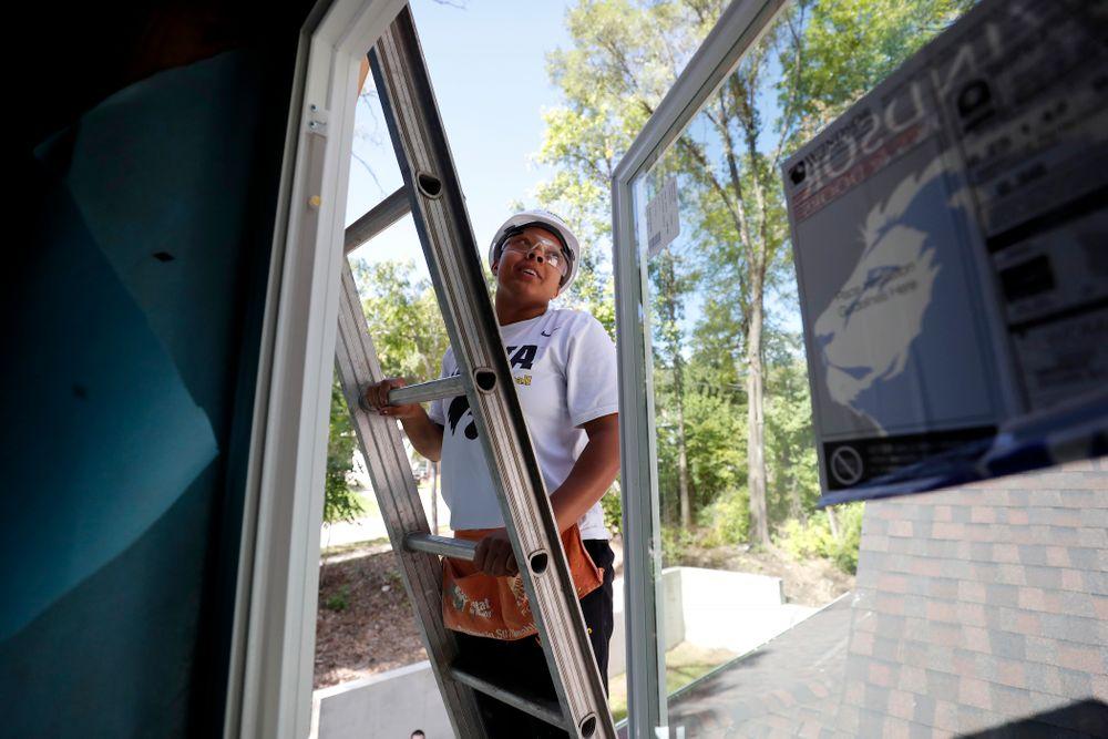 Iowa Hawkeyes guard Tania Davis (11) works on the Habitat for Humanity Women's Build Wednesday, September 26, 2018 in Iowa City. (Brian Ray/hawkeyesports.com)
