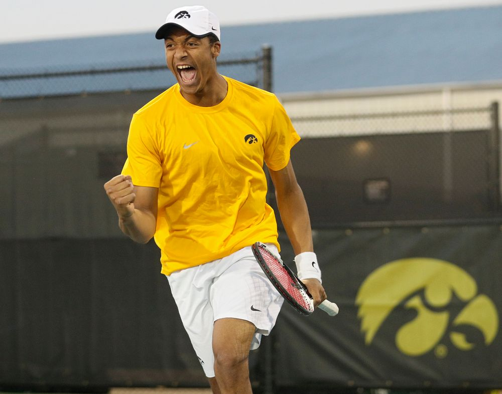 Iowa's Oliver Okonkwo celebrates a point during his match again Michigan State at the Hawkeye Tennis and Recreation Complex in Iowa City on Friday, Apr. 19, 2019. (Stephen Mally/hawkeyesports.com)