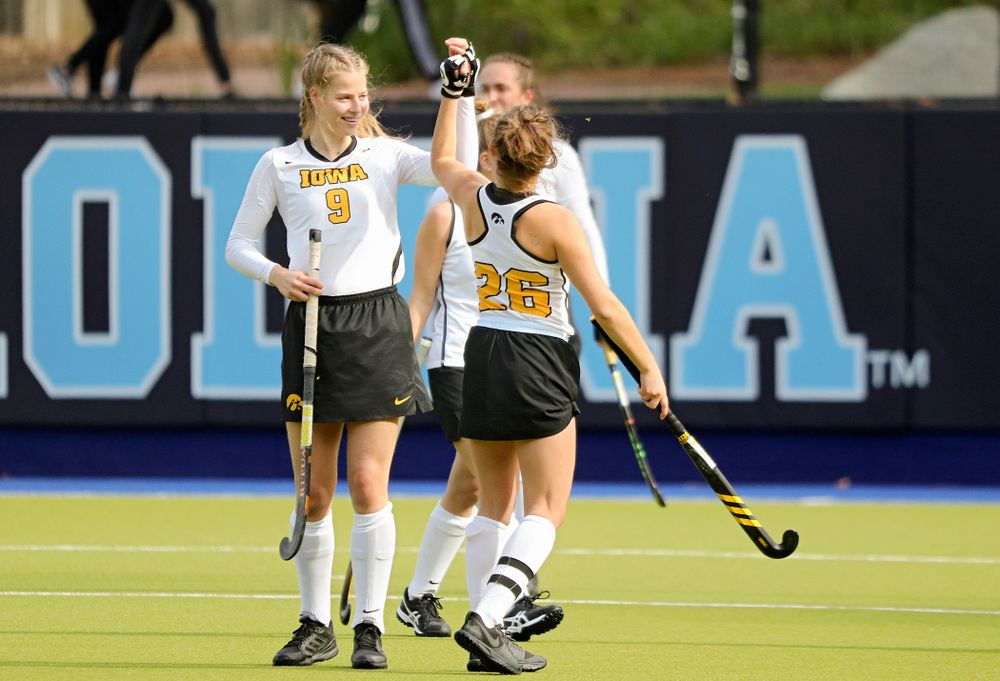 Iowa's Sofie Stribos (9) and Maddy Murphy (26) high-five before their NCAA Tournament Second Round match against North Carolina at Karen Shelton Stadium in Chapel Hill, N.C. on Sunday, Nov 17, 2019. (Stephen Mally/hawkeyesports.com)