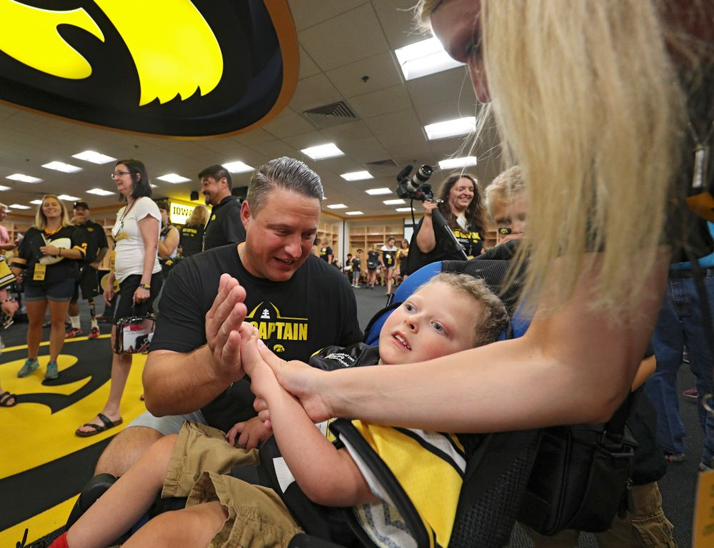 Iowa Hawkeyes offensive coordinator Brian Ferentz gets a high five from Kid Captain Cooper Leeman during Kids Day at Kinnick Stadium in Iowa City on Saturday, Aug 10, 2019. (Stephen Mally/hawkeyesports.com)
