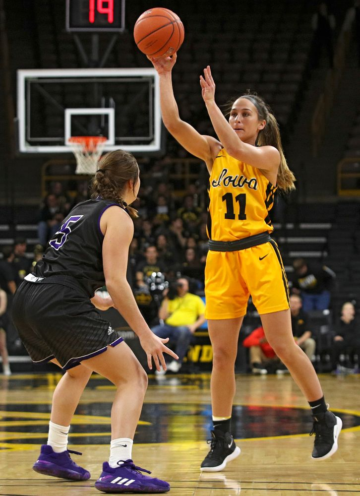 Iowa guard Megan Meyer (11) passes the ball during the fourth quarter of their game against Winona State at Carver-Hawkeye Arena in Iowa City on Sunday, Nov 3, 2019. (Stephen Mally/hawkeyesports.com)