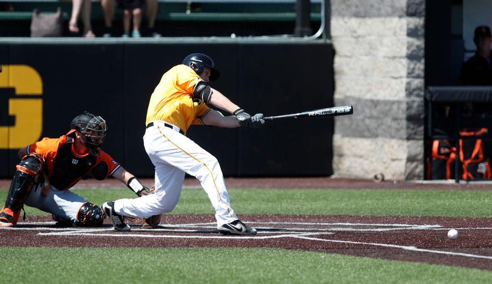 Iowa Hawkeyes outfielder Robert Neustrom (44) doubles against the Oklahoma State Cowboys Sunday, May 6, 2018 at Duane Banks Field. (Brian Ray/hawkeyesports.com)