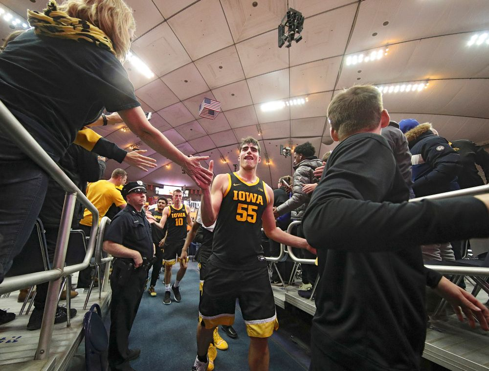 Iowa Hawkeyes center Luka Garza (55) greets fans after winning their ACC/Big Ten Challenge game at the Carrier Dome in Syracuse, N.Y. on Tuesday, Dec 3, 2019. (Stephen Mally/hawkeyesports.com)