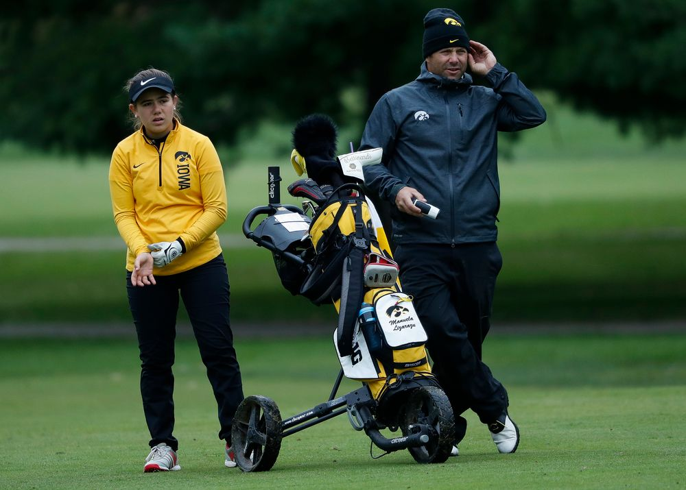 Iowa's Manuela Lizarazu gets instruction from Iowa assistant coach Michael Roters during the Diane Thomason Invitational at Finkbine Golf Course on September 29, 2018. (Tork Mason/hawkeyesports.com)