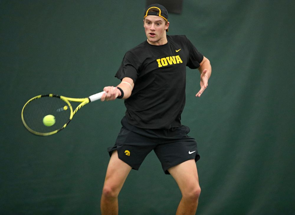 Iowa's Joe Tyler hits a shot during his match against Marquette at the Hawkeye Tennis and Recreation Complex in Iowa City on Saturday, January 25, 2020. (Stephen Mally/hawkeyesports.com)