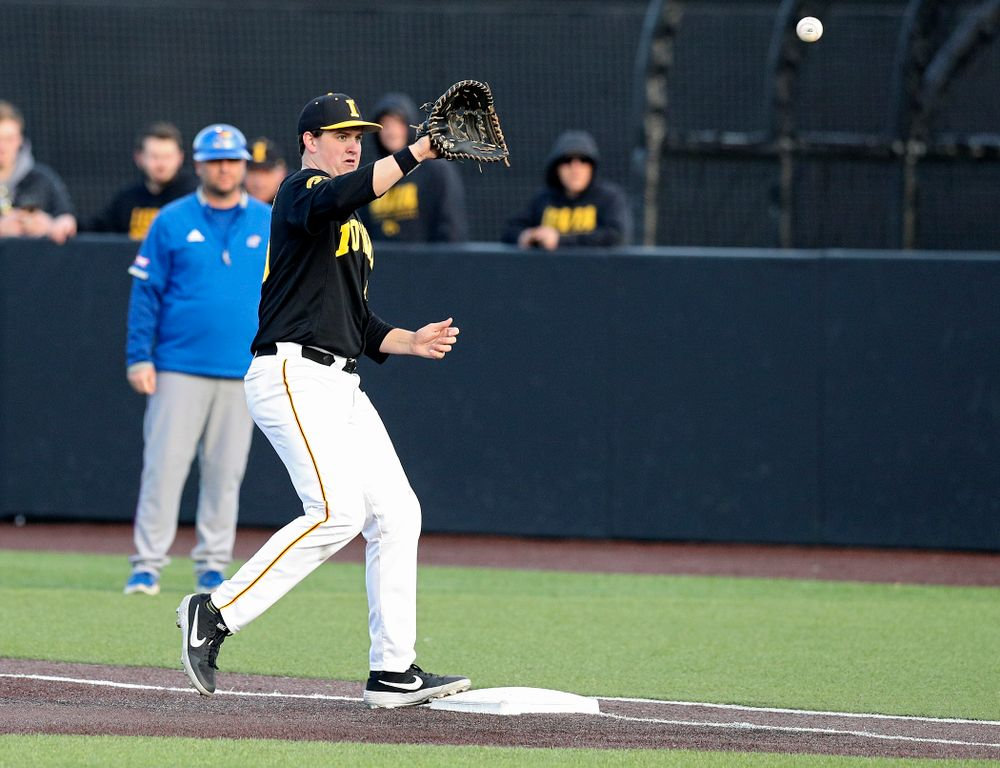 Iowa first baseman Peyton Williams (45) looks in a throw for an out during the seventh inning of their college baseball game at Duane Banks Field in Iowa City on Tuesday, March 10, 2020. (Stephen Mally/hawkeyesports.com)