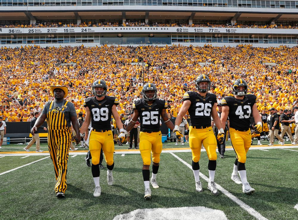 Fred Barr with captains Matt VandeBerg, Akrum Wadley, Kevin Ward, and Josey Jewell