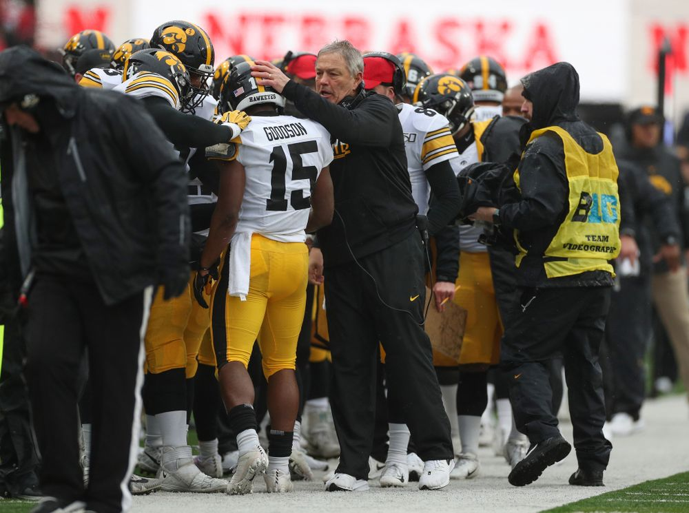 Iowa Hawkeyes running back Tyler Goodson (15) is congratulated by head coach Kirk Ferentz after scoring against the Nebraska Cornhuskers Friday, November 29, 2019 at Memorial Stadium in Lincoln, Neb. (Brian Ray/hawkeyesports.com)