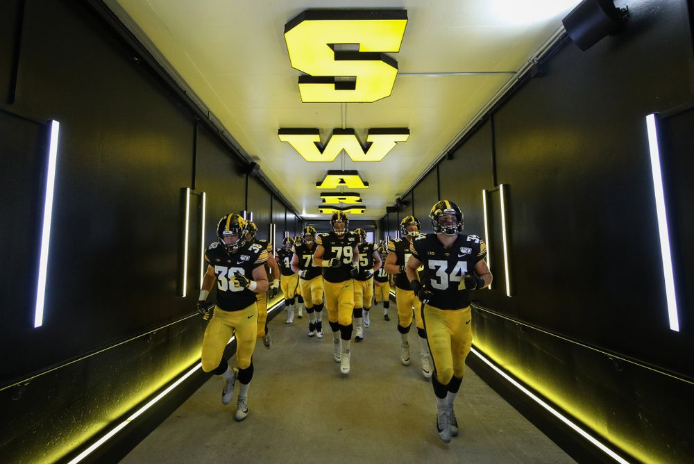 The Iowa Hawkeyes return to the locker room following their game against the Miami RedHawks Saturday, August 31, 2019 at Kinnick Stadium in Iowa City. (Brian Ray/hawkeyesports.com)