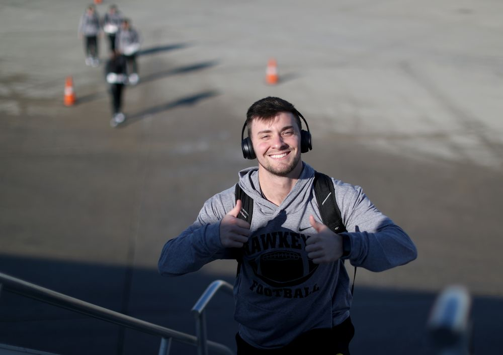 Iowa Hawkeyes place kicker Keith Duncan (3) boards the team plane at the Eastern Iowa Airport Saturday, December 21, 2019 on the way to San Diego, CA for the Holiday Bowl. (Brian Ray/hawkeyesports.com)