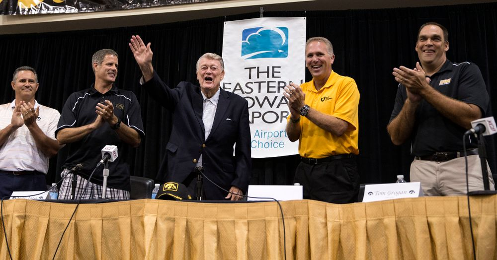 Former Hawkeye Football Head Coach Hayden Fry waves to the crowd following a panel discussion with former quarterback Chuck Long during a panel discussion at Fry Fest Friday, Aug. 29, 2014 in Coralville.  (Brian Ray/hawkeyesports.com)