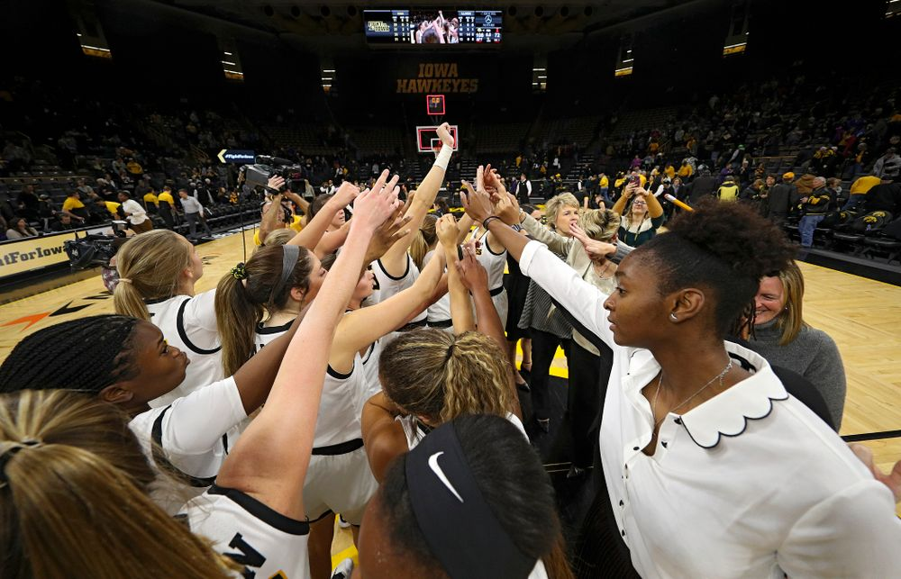 The Hawkeyes huddle after winning their game at Carver-Hawkeye Arena in Iowa City on Tuesday, December 31, 2019. (Stephen Mally/hawkeyesports.com)