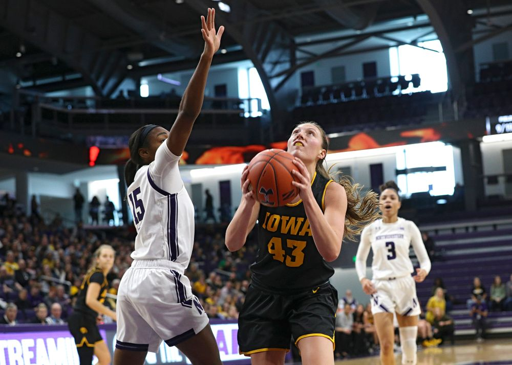 Iowa Hawkeyes forward Amanda Ollinger (43) drives to the basket and scores during the second quarter of their game at Welsh-Ryan Arena in Evanston, Ill. on Sunday, January 5, 2020. (Stephen Mally/hawkeyesports.com)