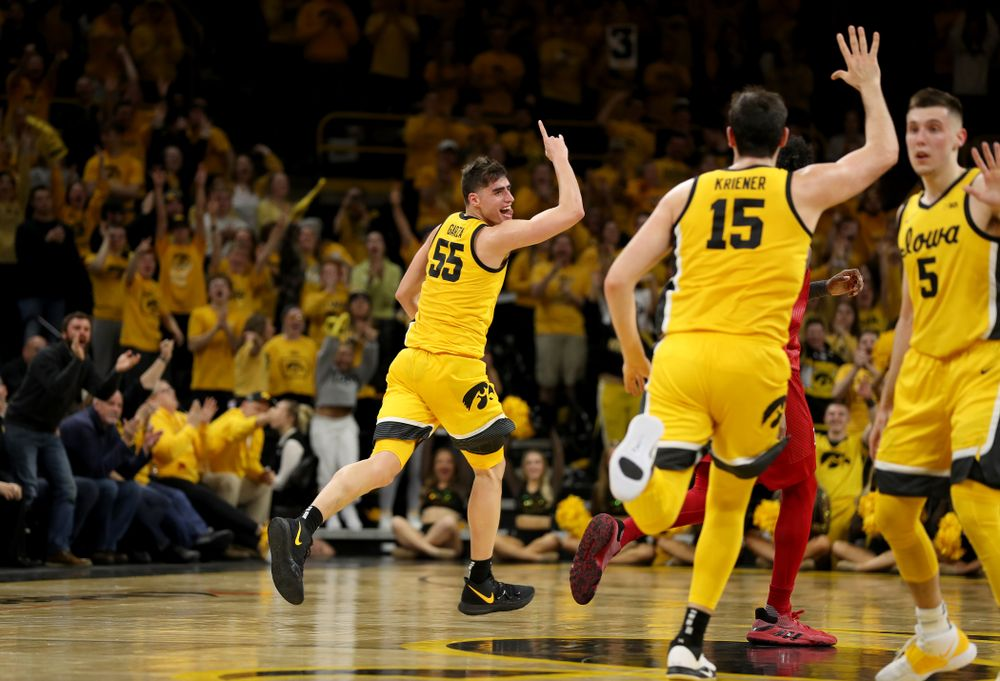 Iowa Hawkeyes forward Luka Garza (55) celebrates a three point basket against the Rutgers Scarlet Knights  Wednesday, January 22, 2020 at Carver-Hawkeye Arena. (Brian Ray/hawkeyesports.com)