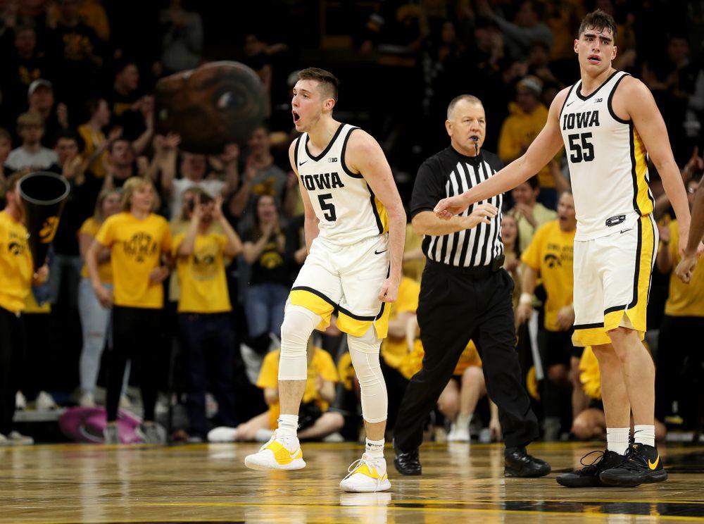 Iowa Hawkeyes guard CJ Fredrick (5) celebrates a three point basket against the Michigan Wolverines Friday, January 17, 2020 at Carver-Hawkeye Arena. (Brian Ray/hawkeyesports.com)