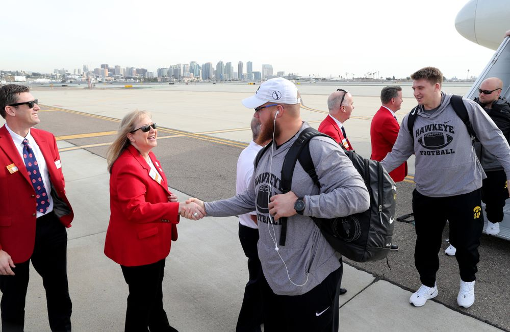 Iowa Hawkeyes offensive lineman Landan Paulsen (68) shakes hands with the ÒRed CoatsÓ after arriving in San Diego, CA Saturday, December 21, 2019 for the Holiday Bowl. (Brian Ray/hawkeyesports.com)