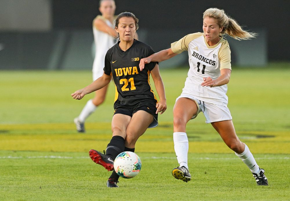 Iowa forward Emma Tokuyama (21) passes during the first half of their match against Western Michigan at the Iowa Soccer Complex in Iowa City on Thursday, Aug 22, 2019. (Stephen Mally/hawkeyesports.com)