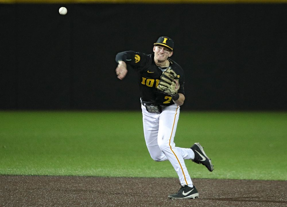 Iowa infielder Brendan Sher (2) throws to first for an out during the eighth inning of their game at Duane Banks Field in Iowa City on Tuesday, March 3, 2020. (Stephen Mally/hawkeyesports.com)