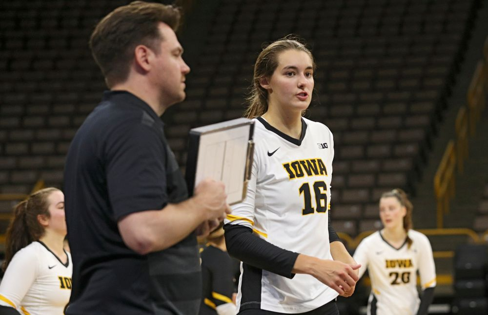 Iowa's Grace Tubbs (16) talks with assistant coach Bobby Hughes during the second set of the Black and Gold scrimmage at Carver-Hawkeye Arena in Iowa City on Saturday, Aug 24, 2019. (Stephen Mally/hawkeyesports.com)