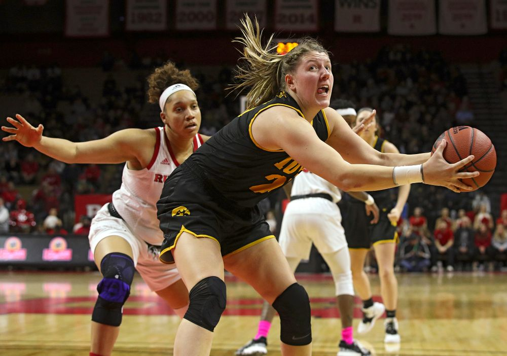 Iowa forward/center Monika Czinano (25) pulls in a pass during the first quarter of their game at the Rutgers Athletic Center in Piscataway, N.J. on Sunday, March 1, 2020. (Stephen Mally/hawkeyesports.com)