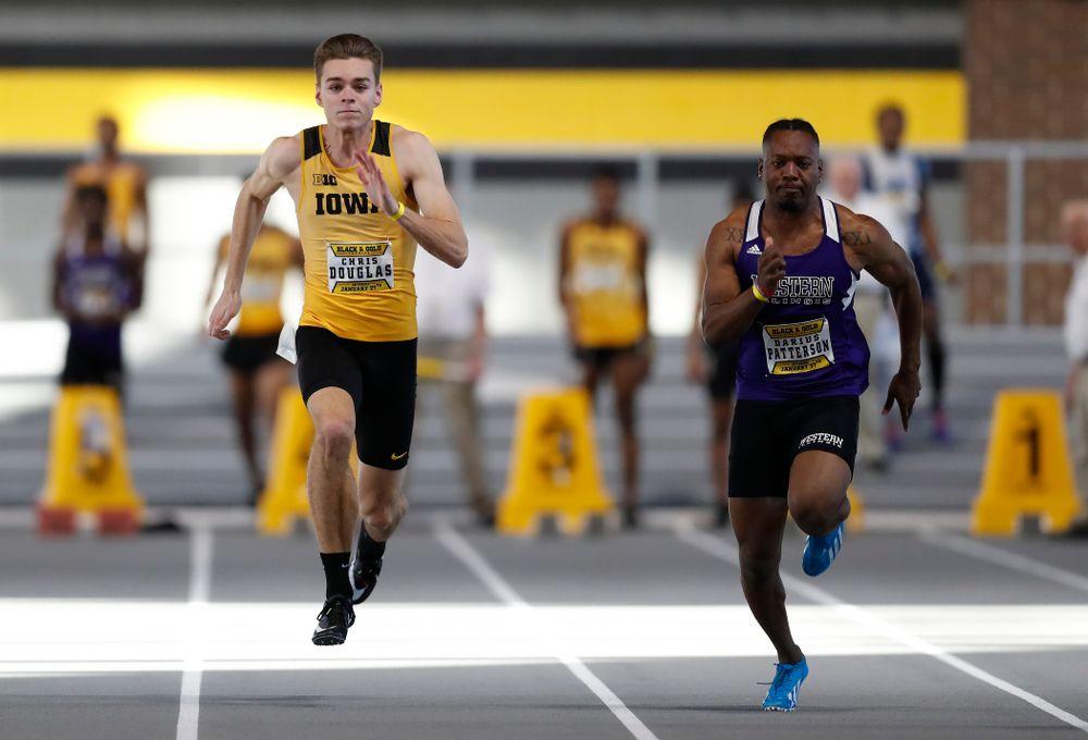 Chris Douglas competes in 60 meter dash