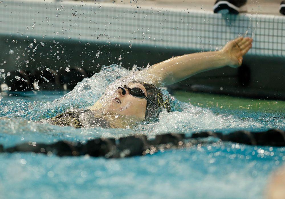 Iowa's Jo Jekel swims the 100 yard backstroke