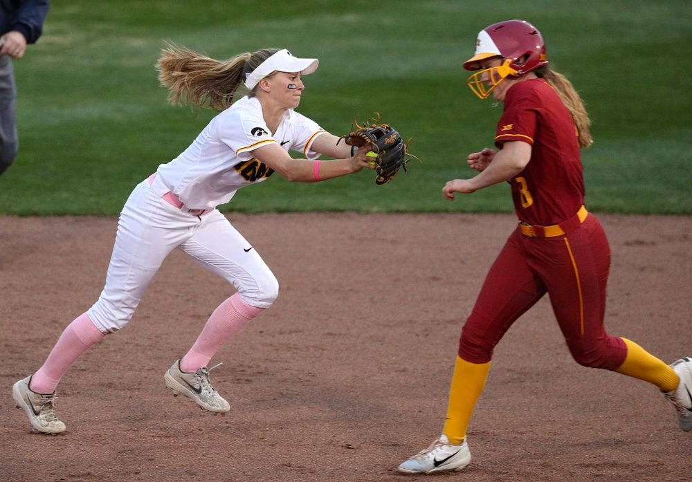 Iowa second baseman Aralee Bogar (2) tags out the runner as she turns a double play during the fifth inning of their game against Iowa State at Pearl Field in Iowa City on Tuesday, Apr. 9, 2019. (Stephen Mally/hawkeyesports.com)