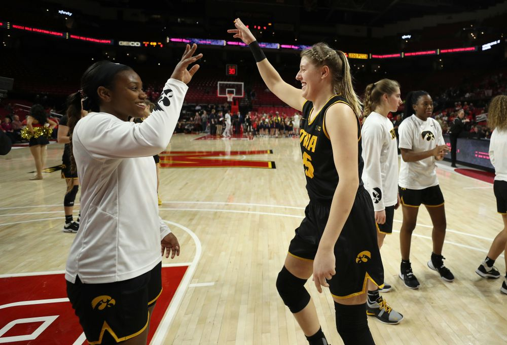 Iowa Hawkeyes forward/center Monika Czinano (25) and guard Zion Sanders (21) against the Maryland Terrapins Thursday, February 13, 2020 at the Xfinity Center in College Park, MD. (Brian Ray/hawkeyesports.com)