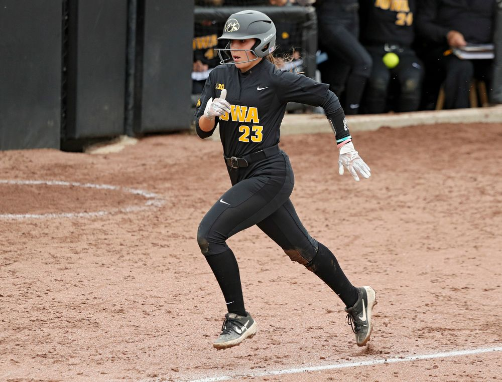 Iowa's Alex Rath (23) runs home and scores a run during the fourth inning of their game against Iowa Softball vs Indian Hills Community College at Pearl Field in Iowa City on Sunday, Oct 6, 2019. (Stephen Mally/hawkeyesports.com)