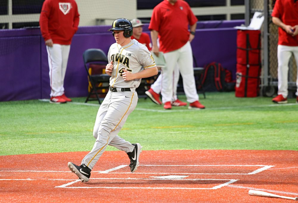 Iowa Hawkeyes first baseman Peyton Williams (45) scores a run during the fifth inning of their CambriaCollegeClassic game at U.S. Bank Stadium in Minneapolis, Minn. on Friday, February 28, 2020. (Stephen Mally/hawkeyesports.com)