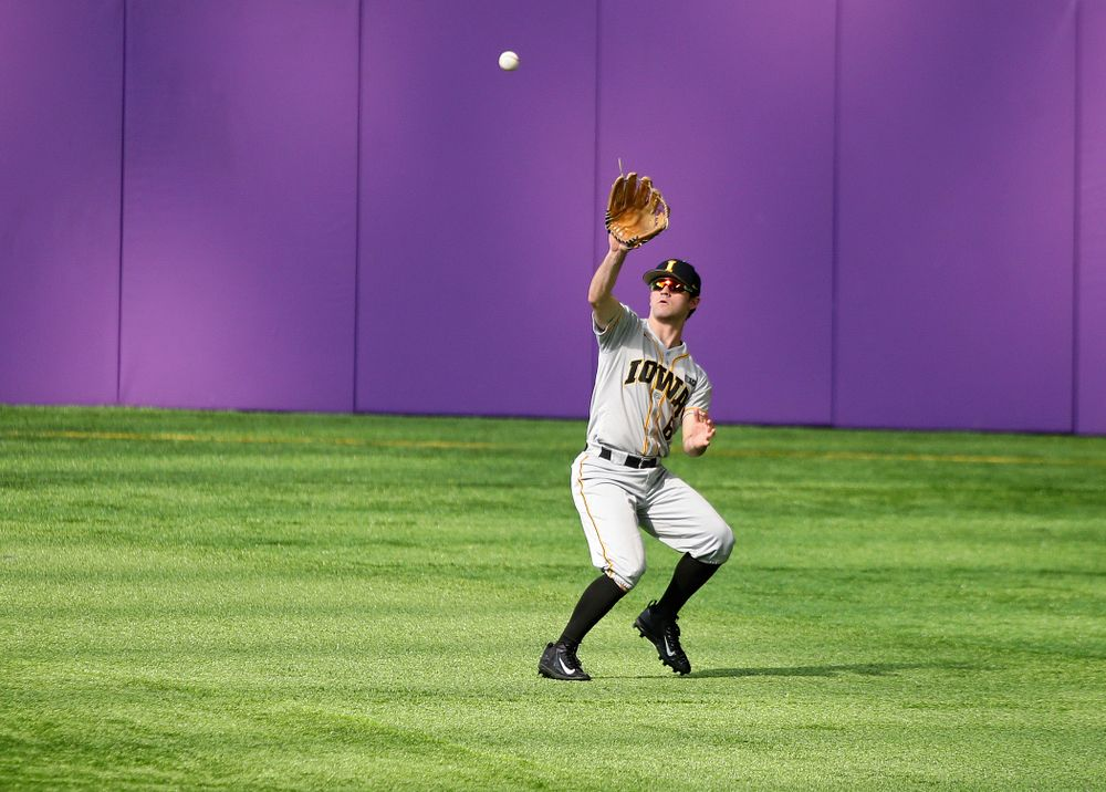 Iowa Hawkeyes outfielder Justin Jenkins (6) pulls in a fly ball for an out during the fourth inning of their CambriaCollegeClassic game at U.S. Bank Stadium in Minneapolis, Minn. on Friday, February 28, 2020. (Stephen Mally/hawkeyesports.com)