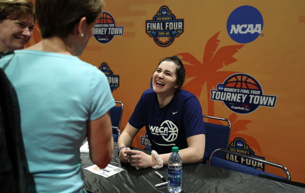 Iowa Hawkeyes forward Megan Gustafson (10) signs autographs with the other WBCA All Americans at the Tourney Town Fan Fest Friday, April 5, 2019 at the Tampa Convention Center in Tampa, FL. (Brian Ray/hawkeyesports.com)