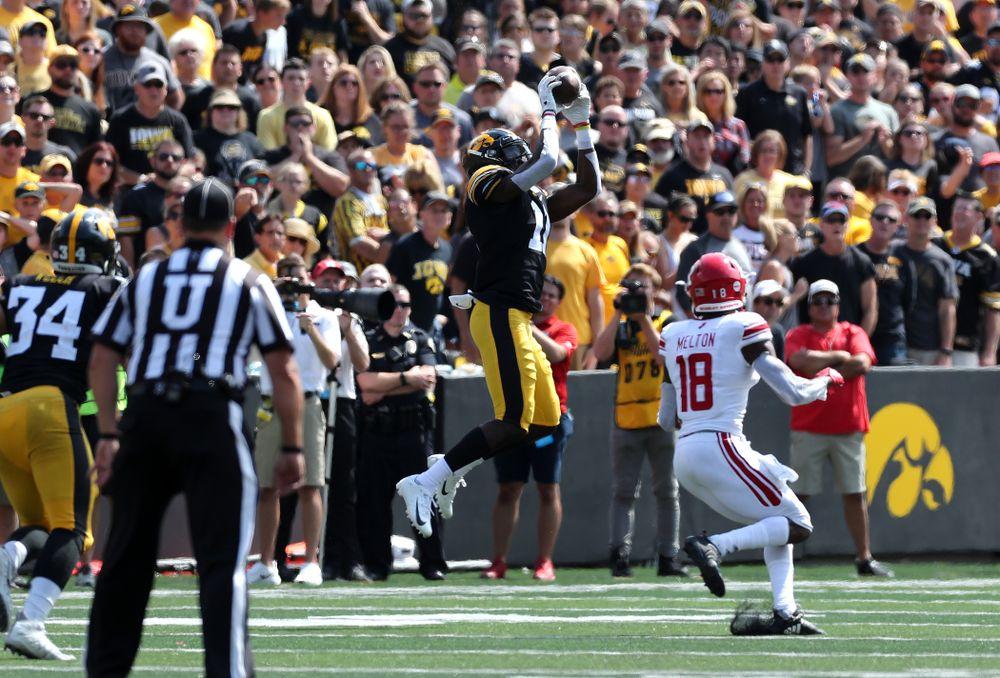 Iowa Hawkeyes defensive back Michael Ojemudia (11) intercepts a pass against the Rutgers Scarlet Knights Saturday, September 7, 2019 at Kinnick Stadium. (Brian Ray/hawkeyesports.com)