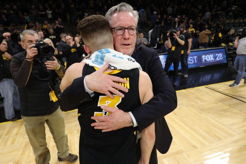 Iowa Hawkeyes guard Jordan Bohannon (3) hugs Iowa Hawkeyes head coach Fran McCaffery after defeating the Indiana Hoosiers in overtime Friday, February 22, 2019 at Carver-Hawkeye Arena. (Brian Ray/hawkeyesports.com)