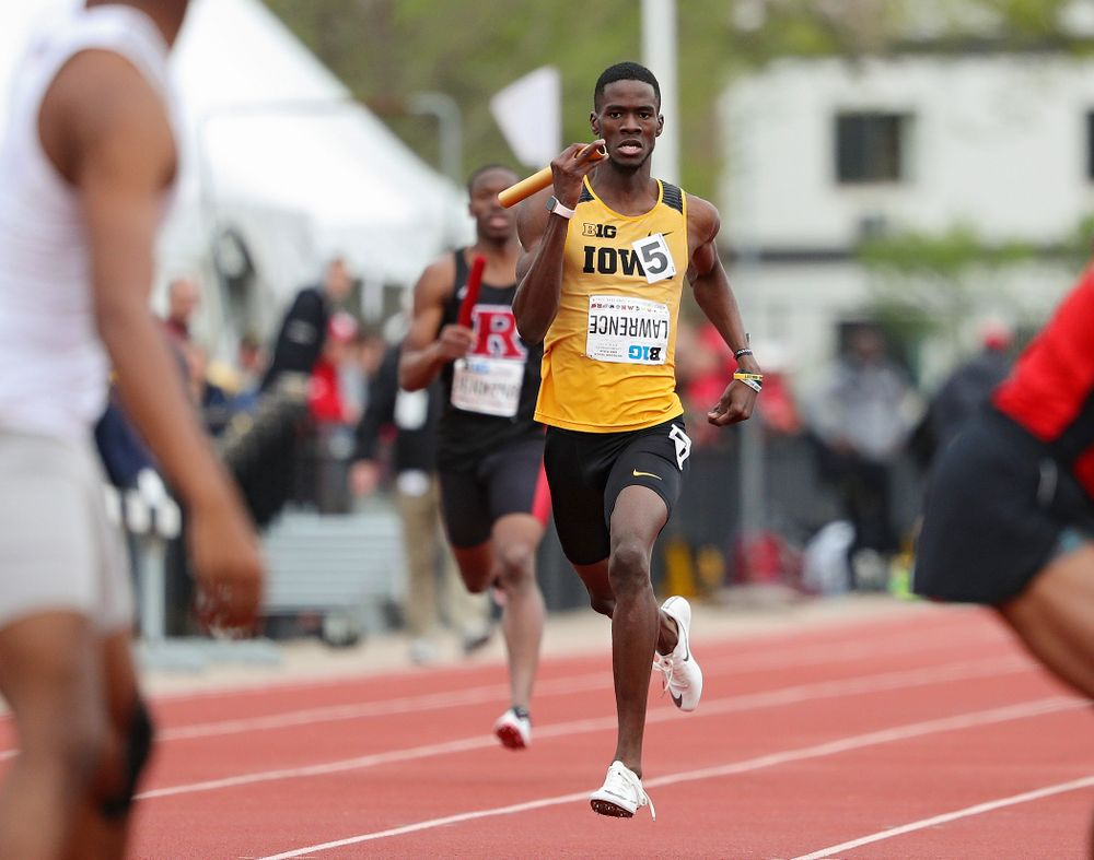 Iowa's Wayne Lawrence Jr. runs his section of the 1600 meter relay event on the third day of the Big Ten Outdoor Track and Field Championships at Francis X. Cretzmeyer Track in Iowa City on Sunday, May. 12, 2019. (Stephen Mally/hawkeyesports.com)
