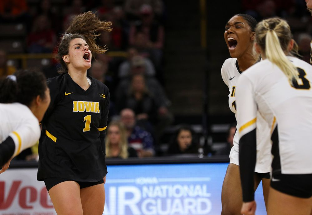 Iowa Hawkeyes defensive specialist Molly Kelly (1) and Iowa Hawkeyes outside hitter Taylor Louis (16) celebrate after winning a point during a match against Nebraska at Carver-Hawkeye Arena on November 7, 2018. (Tork Mason/hawkeyesports.com)