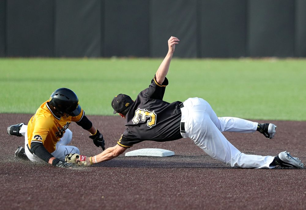 Iowa catcher Brett McCleary (32) avoids a tag by infielder Sam Link (3) as he steals second base during the third inning of the first game of the Black and Gold Fall World Series at Duane Banks Field in Iowa City on Tuesday, Oct 15, 2019. (Stephen Mally/hawkeyesports.com)