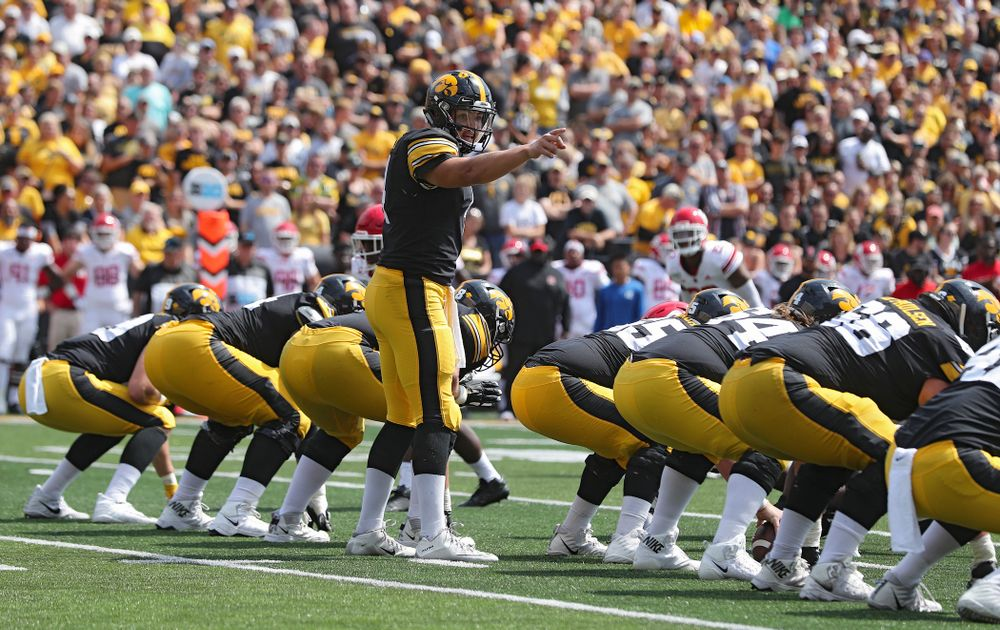 Iowa Hawkeyes quarterback Nate Stanley (4) points at the line during the third quarter of their Big Ten Conference football game at Kinnick Stadium in Iowa City on Saturday, Sep 7, 2019. (Stephen Mally/hawkeyesports.com)