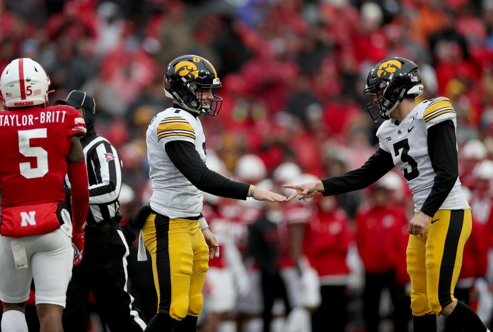 Iowa Hawkeyes place kicker Keith Duncan (3) beats punter Colten Rastetter (7) at Rock Paper Scissors after a kick against the Nebraska Cornhuskers Friday, November 29, 2019 at Memorial Stadium in Lincoln, Neb. (Brian Ray/hawkeyesports.com)