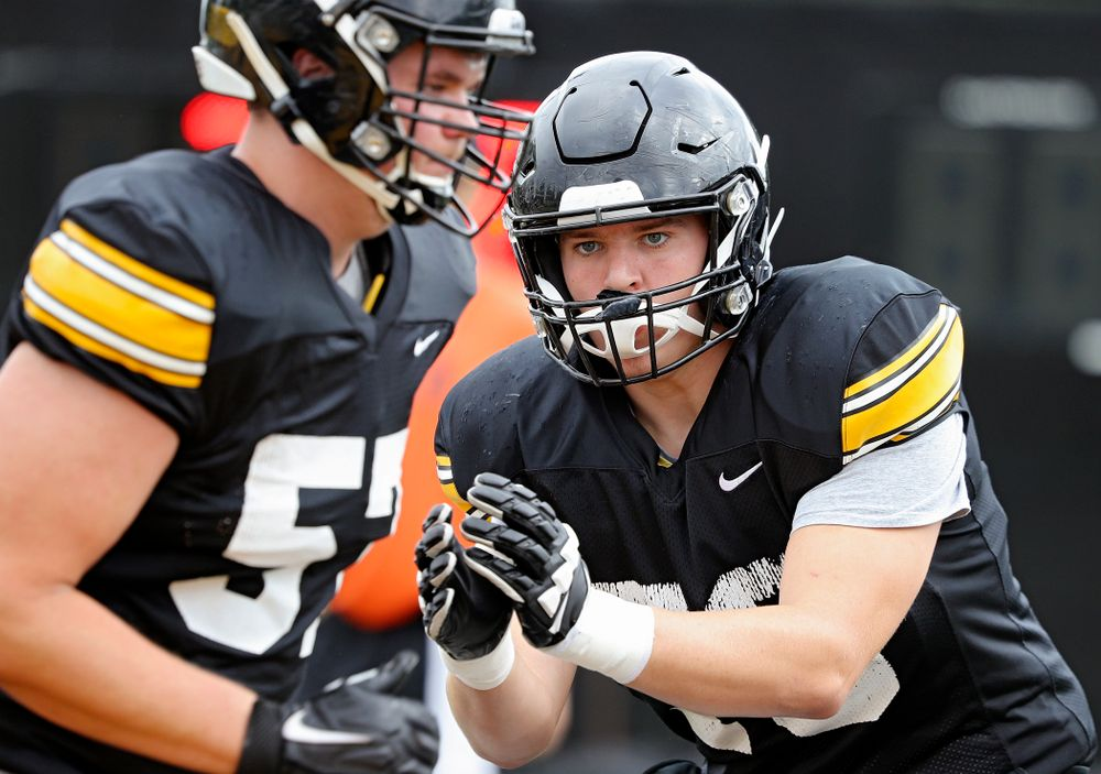 Iowa Hawkeyes offensive lineman Kyle Sorensen (70) eyes offensive lineman Clayton Thurm (57) as they run a drill during Fall Camp Practice No. 15 at the Hansen Football Performance Center in Iowa City on Monday, Aug 19, 2019. (Stephen Mally/hawkeyesports.com)