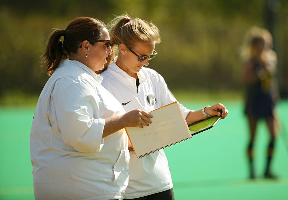 Iowa head coach Lisa Cellucci (from left) talks with assistant coach Roz Ellis during the third quarter of their game at Grant Field in Iowa City on Friday, Sep 13, 2019. (Stephen Mally/hawkeyesports.com)