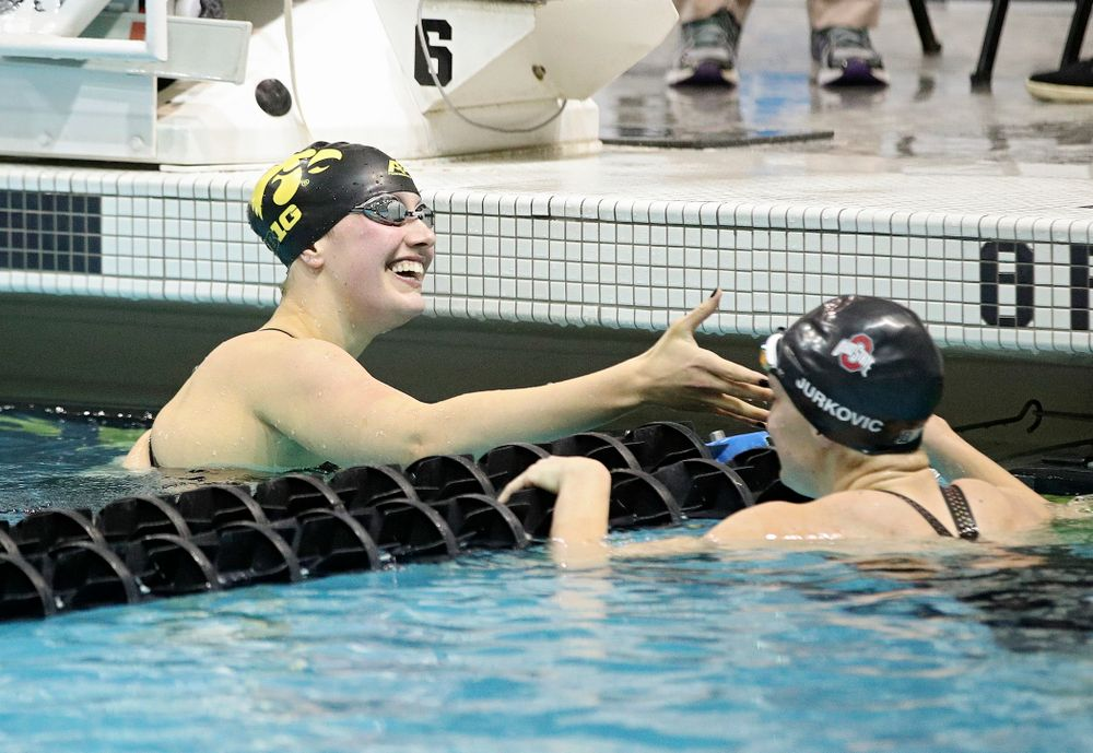 Iowa's Hannah Burvill shakes hands with Ohio State's Lucija Jurkovic-Perisa after swimming the women's 200 yard freestyle final event during the 2020 Women's Big Ten Swimming and Diving Championships at the Campus Recreation and Wellness Center in Iowa City on Friday, February 21, 2020. (Stephen Mally/hawkeyesports.com)