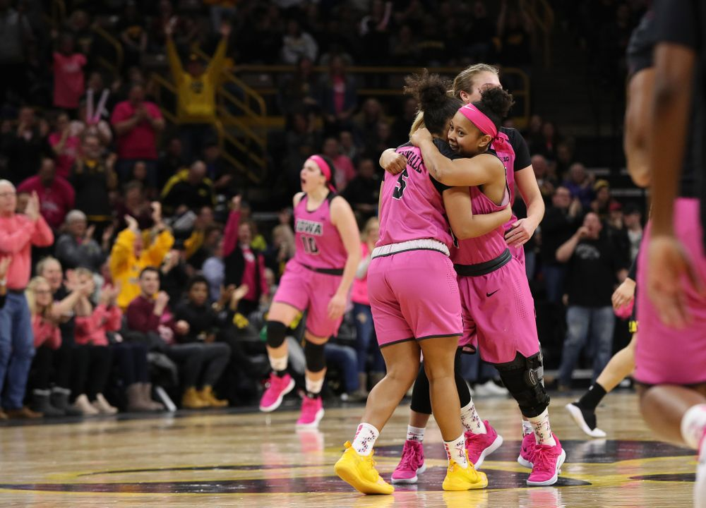 Iowa Hawkeyes guard Tania Davis (11) hugs guard Alexis Sevillian (5) after a three point basket against the seventh ranked Maryland Terrapins Sunday, February 17, 2019 at Carver-Hawkeye Arena. (Brian Ray/hawkeyesports.com)