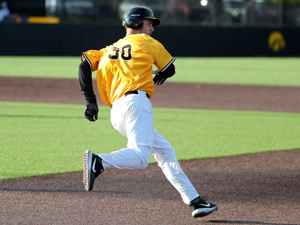 Iowa outfielder Connor McCaffery (30) rounds first base after hitting a 2-run double during the fourth inning of the first game of the Black and Gold Fall World Series at Duane Banks Field in Iowa City on Tuesday, Oct 15, 2019. (Stephen Mally/hawkeyesports.com)